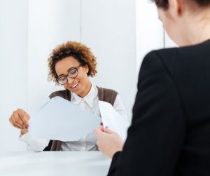 Woman interviewing looking at resume